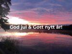 Sjö vid solnedgång med texten God Jul och Gott nytt år